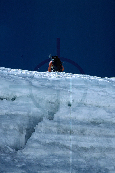 Wrong turn down: abseiling the bergschrund on Illimani South at an Abalakov thread, Cordillera Real, Bolivia