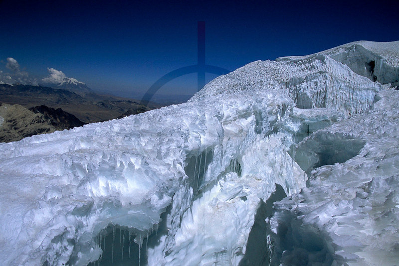 Crevasses on Huayna Potosí and Illimani in the distance, Cordil