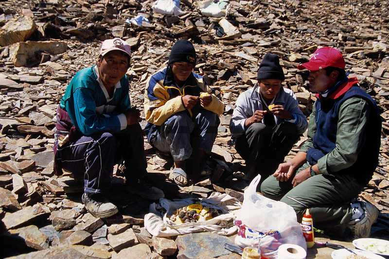 Local porters and staff enjoying their potato lunch, Illimani in between base camp and high camp, Cordillera Real, Bolivia