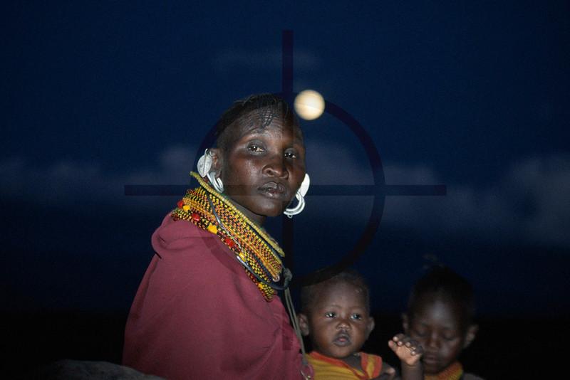 Turkana woman and children at night, Loyangalani, Kenya