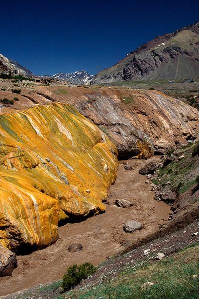 Colorful landscape along upstream Río de las Cuevas near Puente del Inca, Andean mountain range at the border between Chile and Argentina