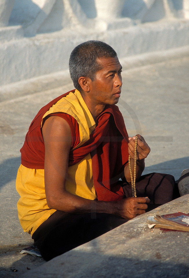 Buddhist monk reciting, Boudhanath, Kathmandu Valley, Nepal