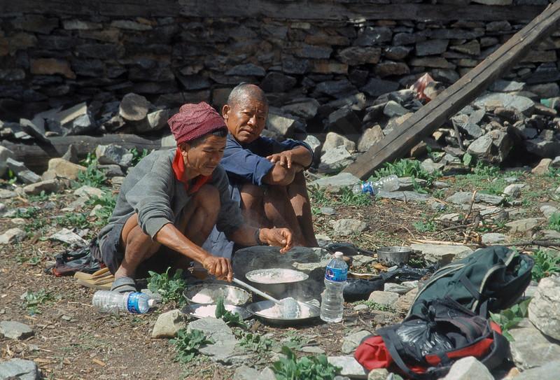 Nepali men taking a break to prepare a meal, Annapurna region, Nepal