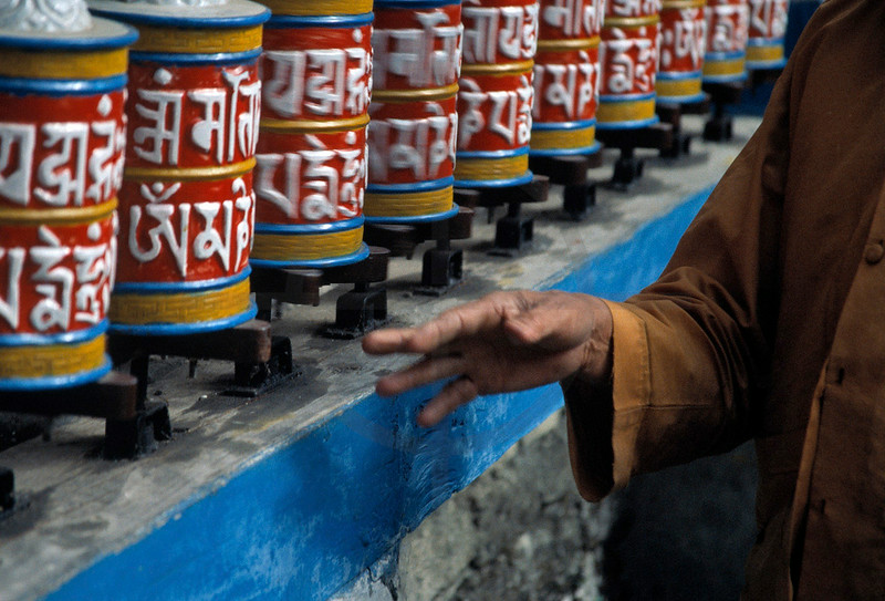 Buddhist monk spinning the prayer wheels at Diki Gompa, Bagarchhap, Annapurna Circuit, Nepal