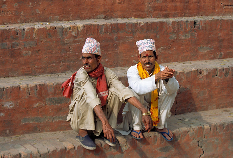 Nepali men sitting on the ghats of the Bagmati River, Pashupatinath, Kathmandu Valley, Nepal
