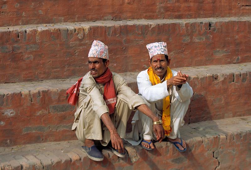 Nepali men sitting on the ghats of the Bagmati River, Pashupatinath, Kathmandu Valley, Nepal