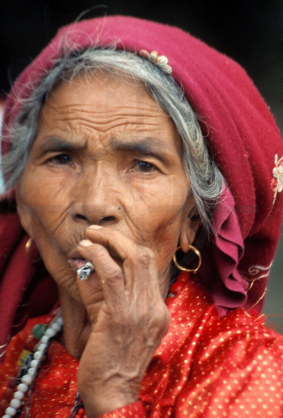 Woman smoking, Patan, Kathmandu Valley, Nepal