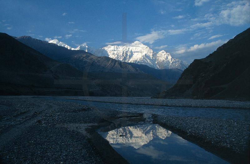 Nilgiri Himal reflected in a pond in the Kali Gandaki River Valley, Annapurna Conservation Area near Kagbeni, Nepal