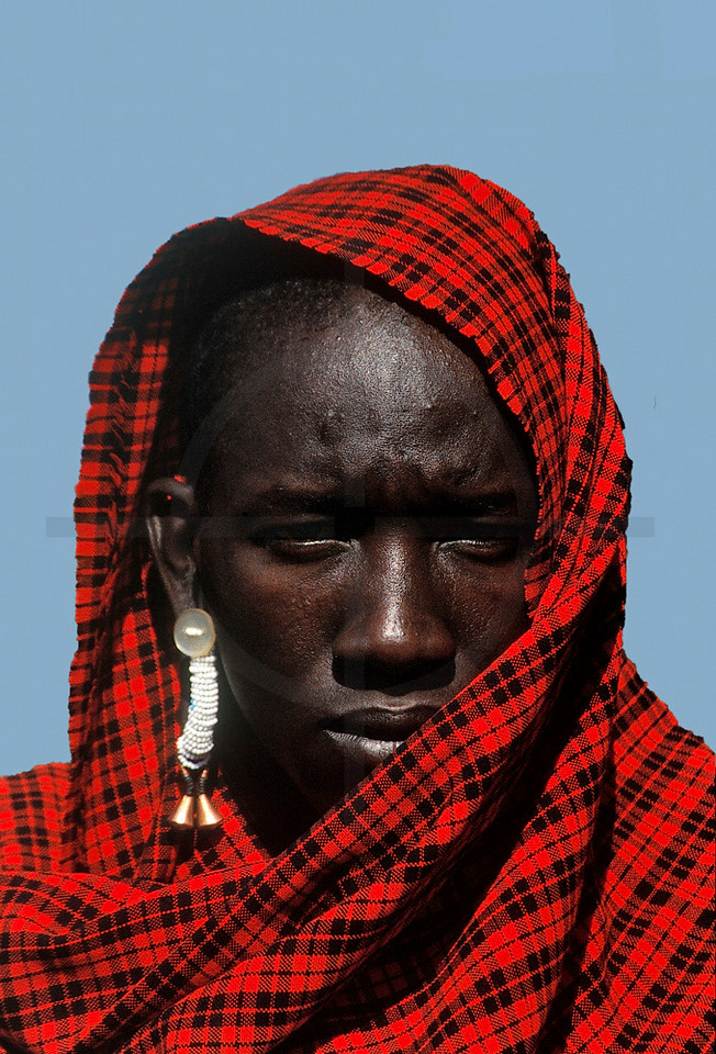 Maasai moran wearing a red-checked shuka, Southwest Kenya
