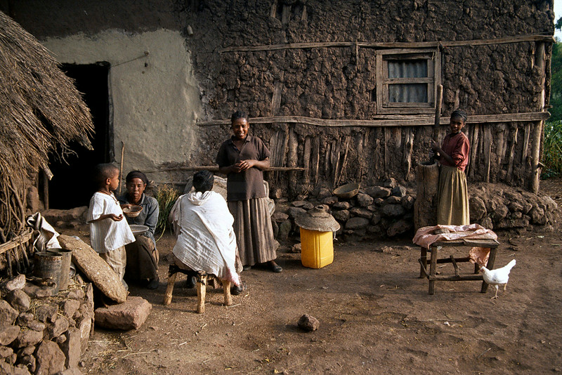 Ethiopian family in front of their home, Lalibela, Northern Ethiopia