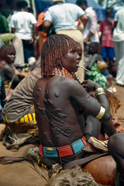 Scars on the back of a Hamer woman from the bull jumping ceremnoy, market in Key Afar, Southern Ethiopia