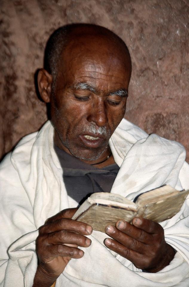 Ethiopian clergyman reading the Bible, Lalibela, Northern Ethiopia