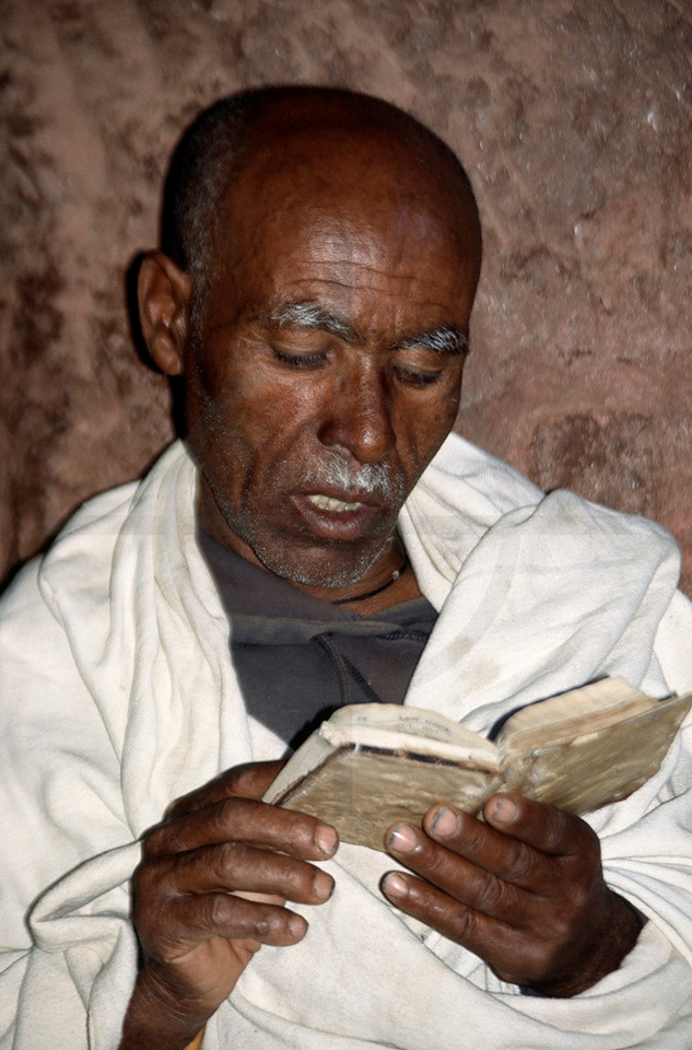 Ethiopian clergyman reading the Bible, Lalibela, Northern Ethiopia