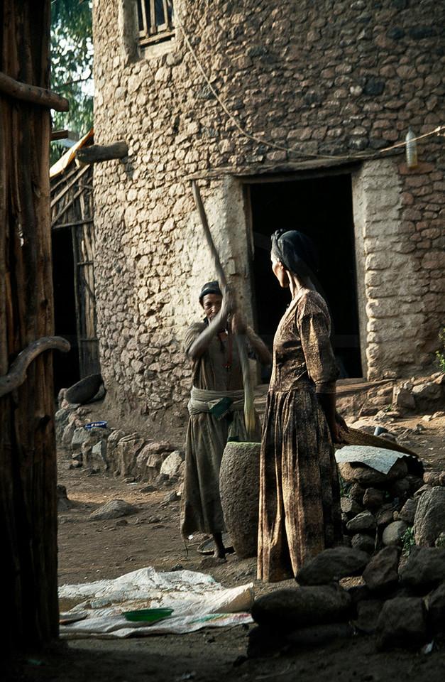 Women preparing food in a mortar, Lalibela, Northern Ethiopia