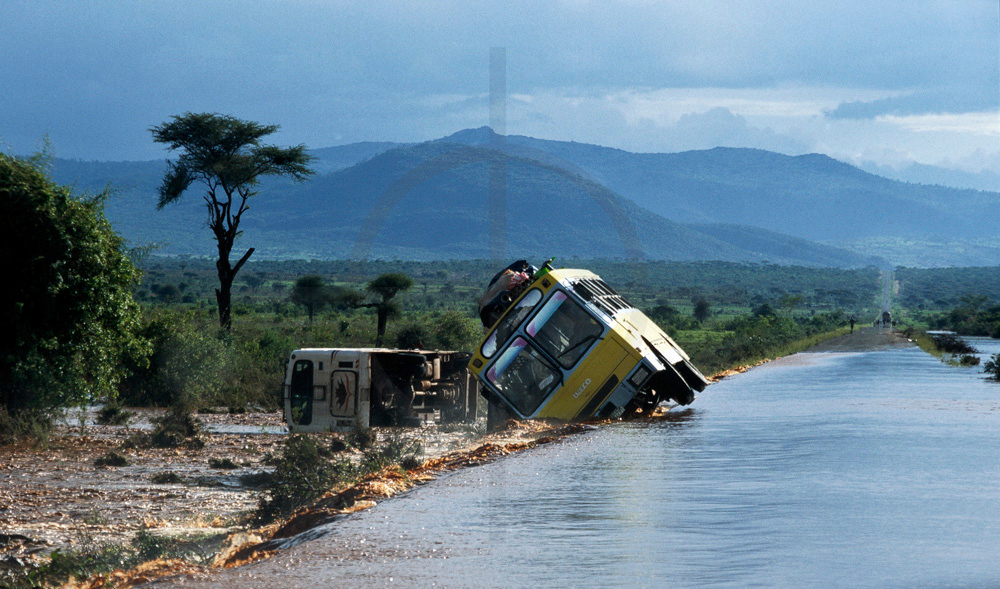 Washed away buses along a flooded road, Southern Ethiopia