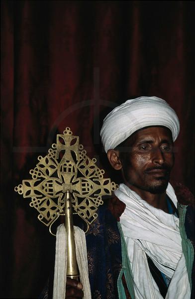 Ethiopian clergyman holding a holy cross, Lalibela, Northern Ethiopia