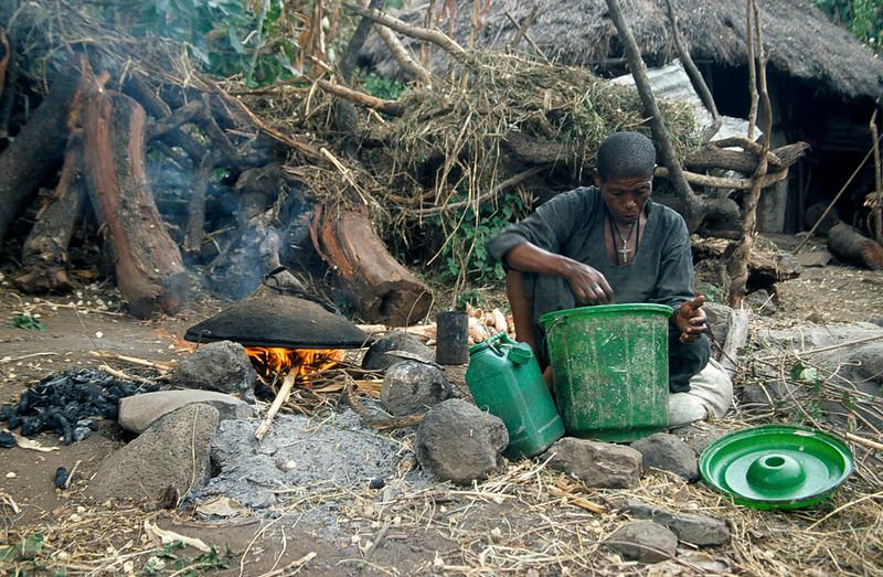 Person preparing injera on a fire outside, Blue Nile Falls area, Northern Ethiopia