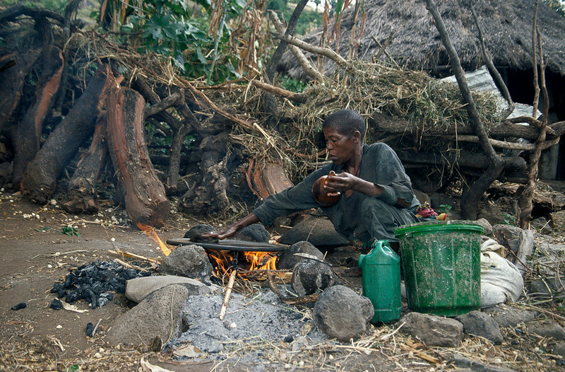 Person preparing injera on a fire outside, Blue Nile Falls area, Northern Ethiopia
