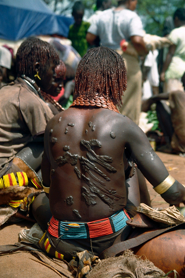 Scars on the back of a  Hamer woman from the bull jumping ceremony, market in Key Afar, Ethiopia