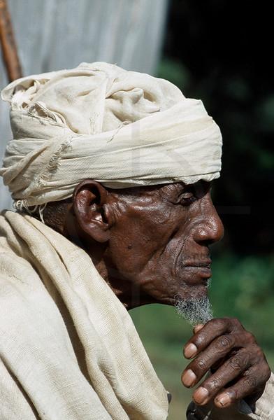 Oriental orthodox christian man outside Ura Kidane Meret Monastry , Zege Peninsula, Bahir Dar and Lake Tana, Northern Ethiopia