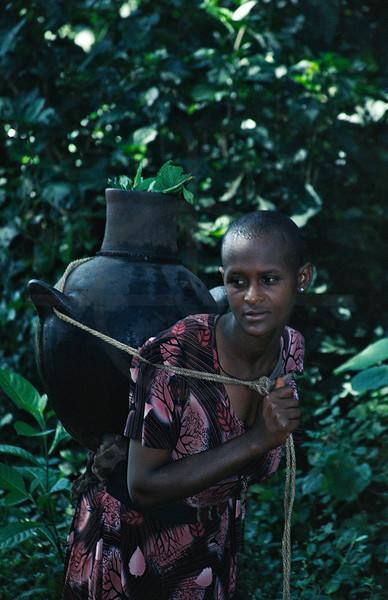 Ethiopian girl carrying a jar, Zege Peninsula, Lake Tana, Northern Ethiopia