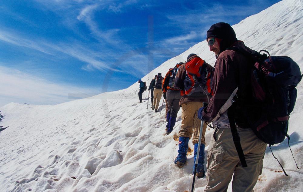 Trekking group heading for the top of Mount M'Goun, High Atlas, Morocco