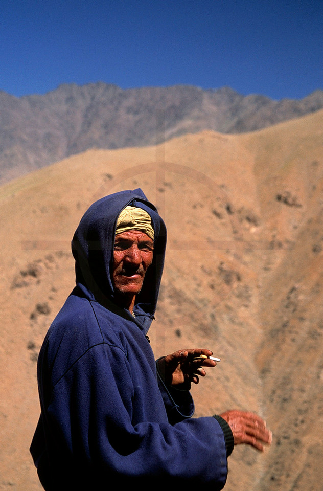 Berber herdsman enjoying a ciragette, High Atlas near Jebel Toubkal, Morocco