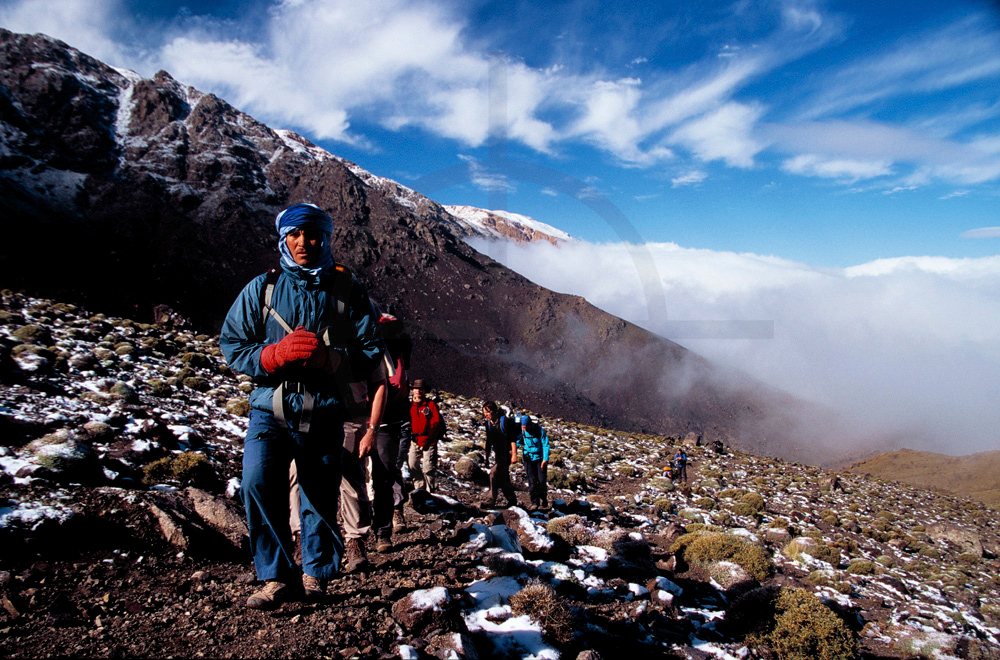 Clouds in the valley after a snowy night, High Atlas near Jebel Toubkal, Morocco
