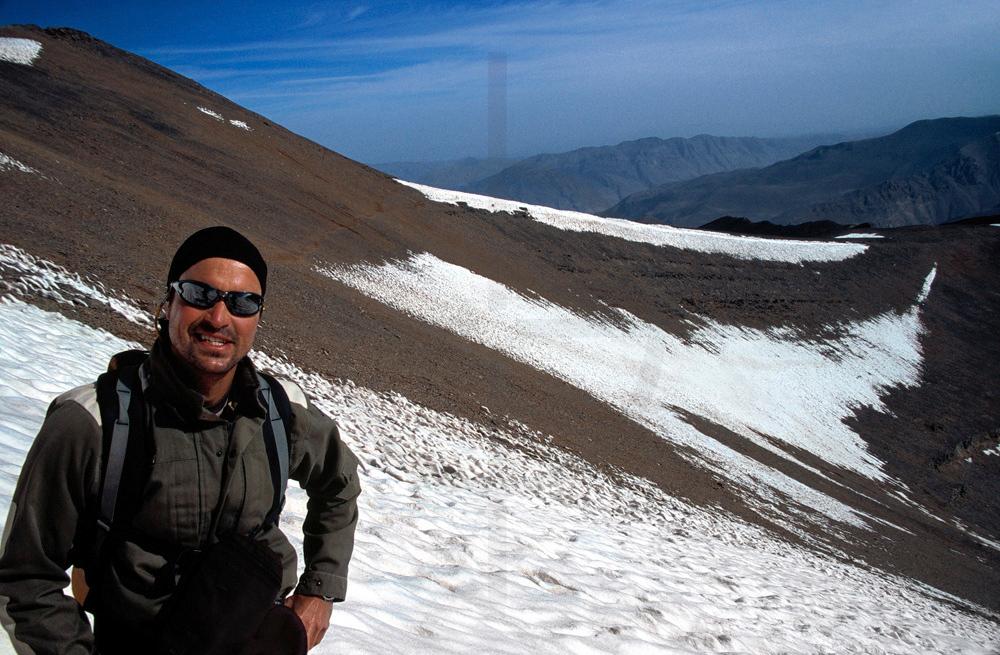 Happy hiker on the snowy slopes of M'Goun mountain, High Atlas, Morocco