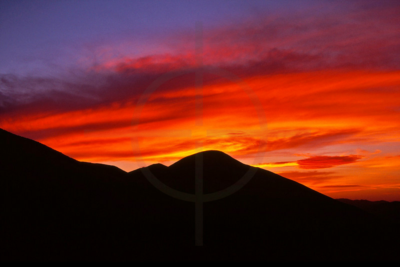 Fire in the sky at dusk, M'Goun area, Morocco