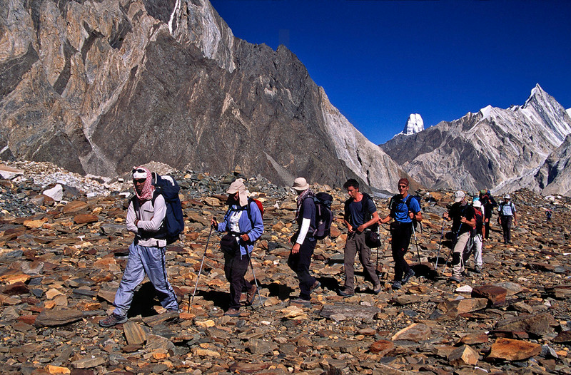 Trekking group on the Upper Baltoro Glacier with Muztagh Tower in the background, Baltistan, Pakistan