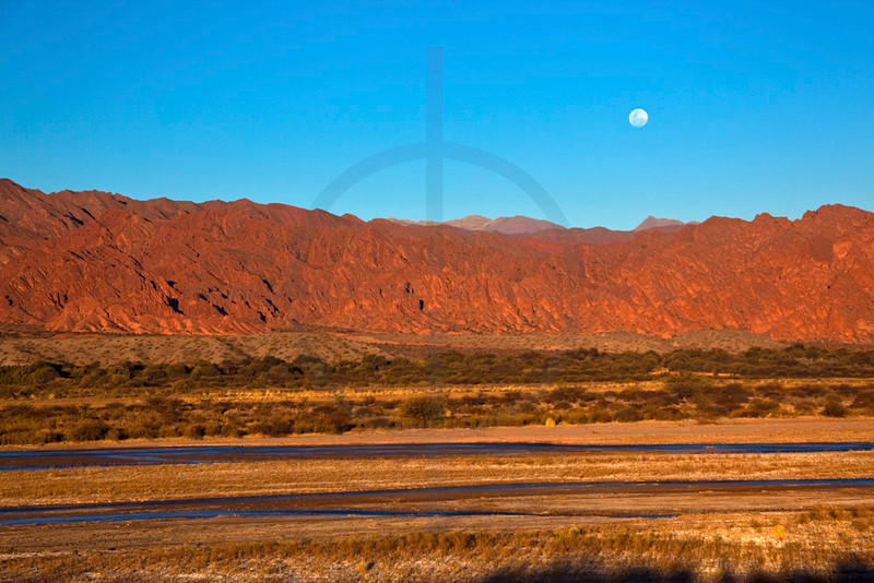 Rising moon over the banks of Rio Calchaqui, Ruta 40 near San Carlos, Salta, Argentina