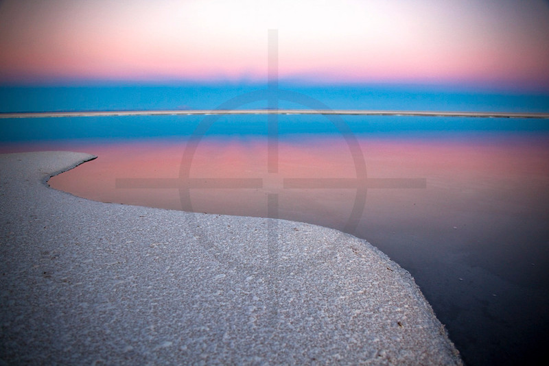 Sunset on the edge of Salar de Uyuni, Bolivia