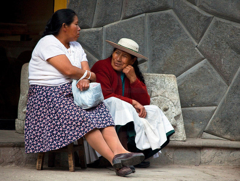 Women sitting, waiting and talking, Aguas Calientes, Peru