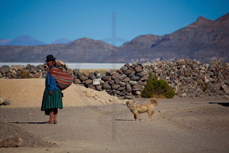 Bolivian woman with dog, Altiplano, Bolivia