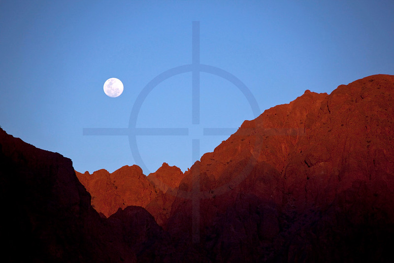 Rising moon over red rocks, Ruta 40 near San Carlos, Salta, Argentina