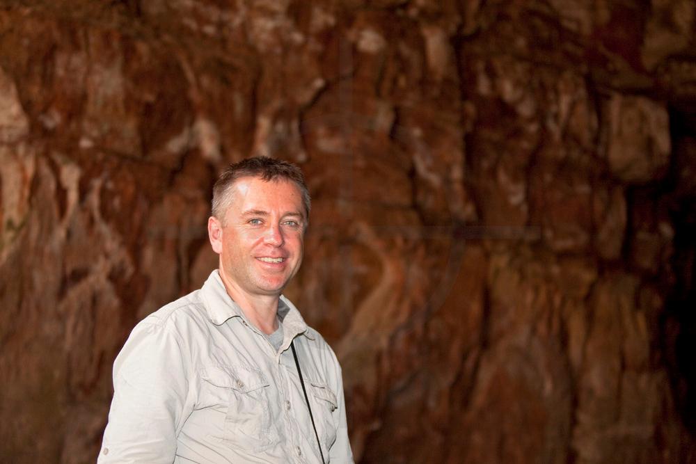 Smiling visitor in Lago Azul Grotto, Chapada dos Guimerães, Mato Grosso, Brazil