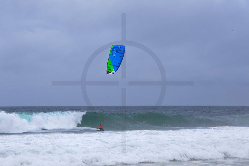 Kite surfer at Ipanema Beach during storm, Rio de Janeiro, Brazil