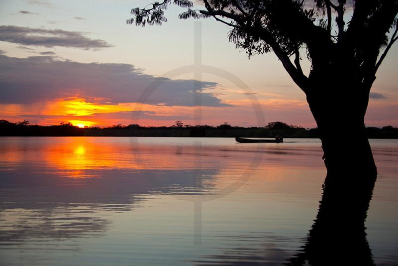Canoe on Laguna Cuyabeno at sunset, Cuyabeno Faunal Reserve