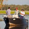 Fishermen, Yellow Water, Coinda,  Kakadu National Park, Northern Territory, Australia