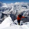 Mountaineer on the summit ridge of Pik Korzhevenskaya, Pamir, Tajikistan