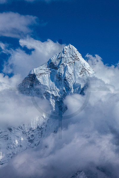 Ama Dablam piercing through the clouds, seen from Cho La, Solukhumbu District, Nepal