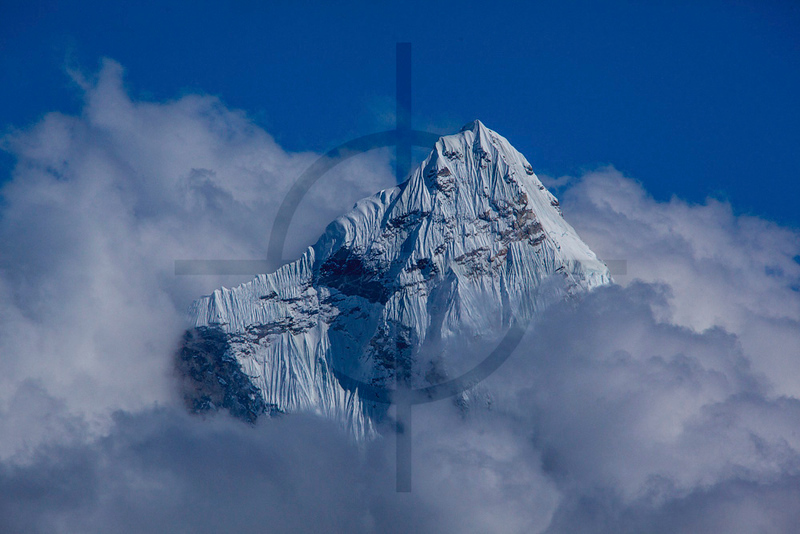Top of Ama dablam piercing through the clouds, as seen from the Cho La Pass, Solukhumbu District, Nepal