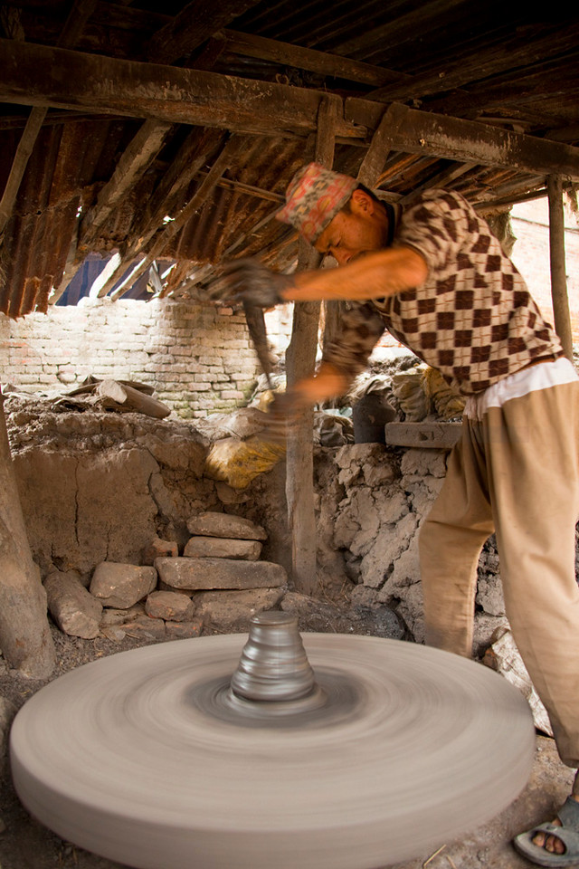 Turning the potter's wheel, Pottery Square, Bhaktapur, Kathandu Valley, Nepal