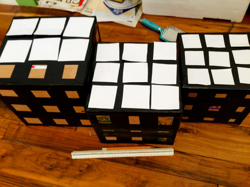 Making Rubik's Cubes for the party decorations.