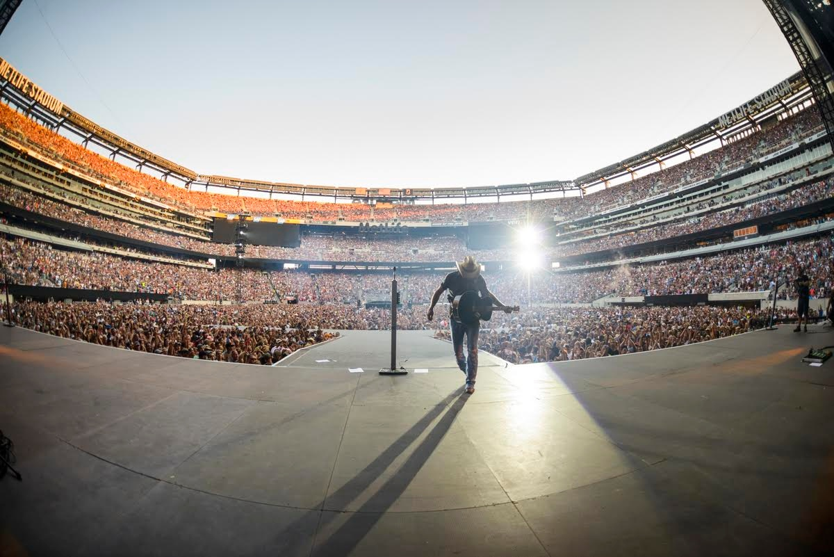 Jason Aldean photographed performing at MetLife stadium in East Rutherford, New Jersey with Kenny Chesney on August 15, 2015.