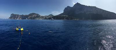Anchored off the coast of Capri... enjoying an afternoon swim.