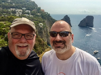 After a long sweaty hike up to the lookout point with the Faraglioni Rocks in the background.