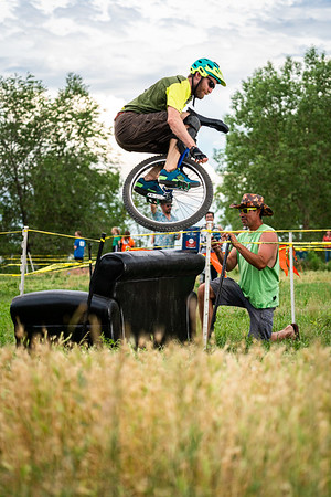 Max Schulze (@thrashwell) bunnyhops over at couch obstacle during the Mountain Unicycle Cyclocross at the 2019 NAUCC event. For reals. Do you think regular cyclocross be more fun if the obstacles included couches? What would a UCI approved couch look like? The uni-cyclocross was held at @newbelgium.  #naucc #naucc2019 #thenbeer #fattire #unicycle