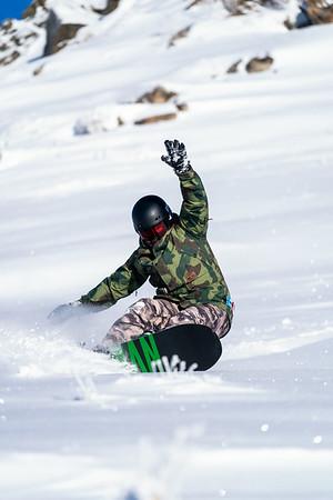 Sean McClendon lays down a heelside turn in some fresh powder while snowboarding at Bogus Basin near Boise, Idaho